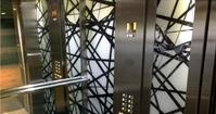 חיפוי זכוכית במעלית